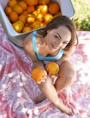 Sabrina Rey petite teen with oranges